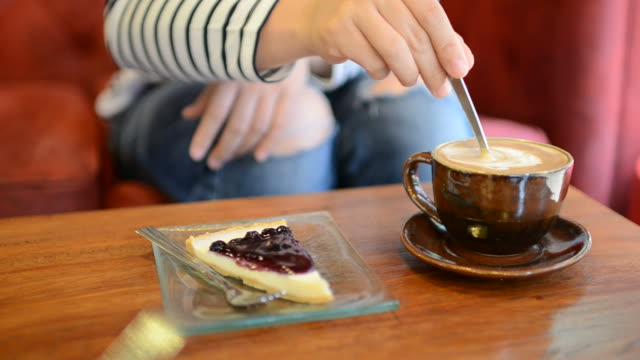HD:Young woman drink coffee and cake blueberry pie in coffee house video