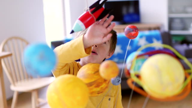 He wants to Fly a Space Rocket Little boy playing with his homemade planetarium as he plays with a rocket hanging above him from some string one boy only stock videos & royalty-free footage