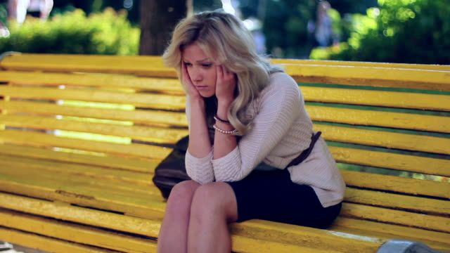 Head ache problem depression sad young business woman in park video