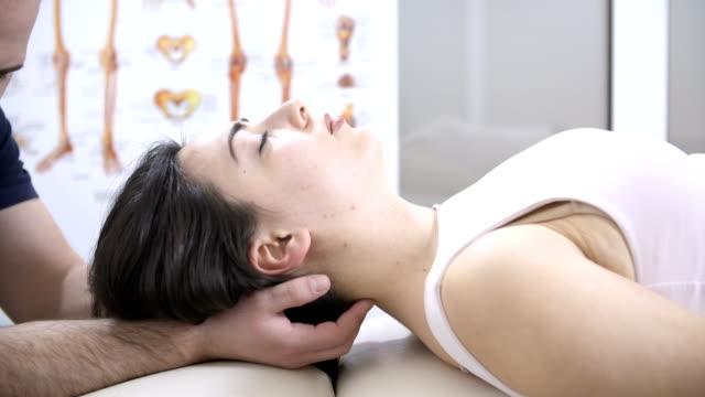 head chiropractic massage - chiropractor stock videos & royalty-free footage