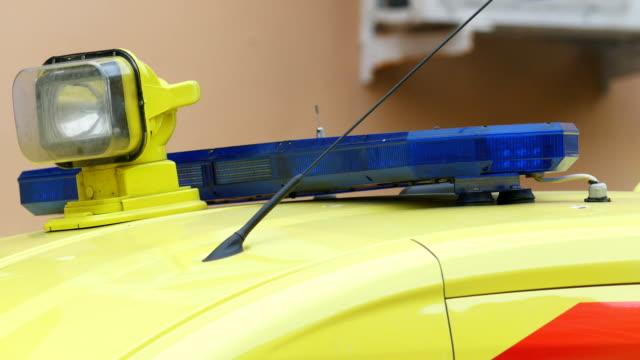 Head flashing light strobe on emergency ambulance car video