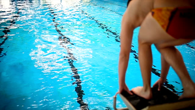 Head Jump In The Swimming Pool Young sportist jumping in the swimming pool competition group stock videos & royalty-free footage