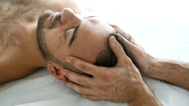 Head massage on patient video