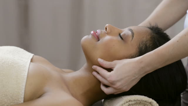Head massage HD1080p: Beautiful relaxed woman receiving a head massage at beauty spa salon. massage stock videos & royalty-free footage