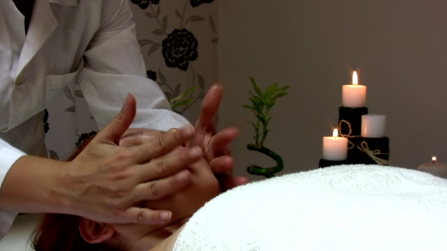 Head massage A woman is getting head massage. HD 1080i. dyed red hair stock videos & royalty-free footage