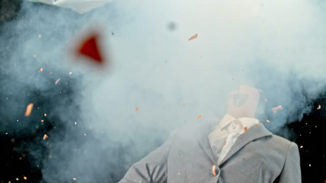 SLO MO LD Head of a female mannequin in a business suit exploding