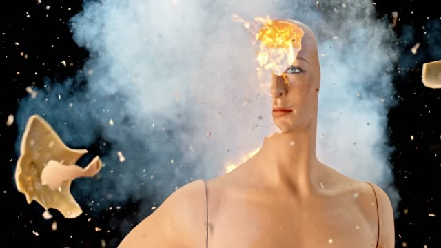 SLO MO LD Head of a mannequin exploding and catching fire