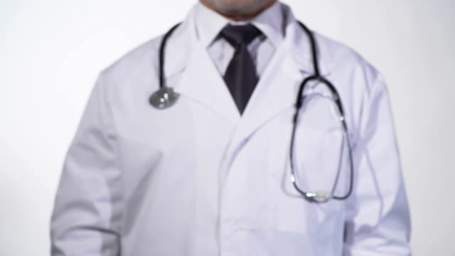 Head with questionmark drawn on blackboard in physician hands, diagnostics video