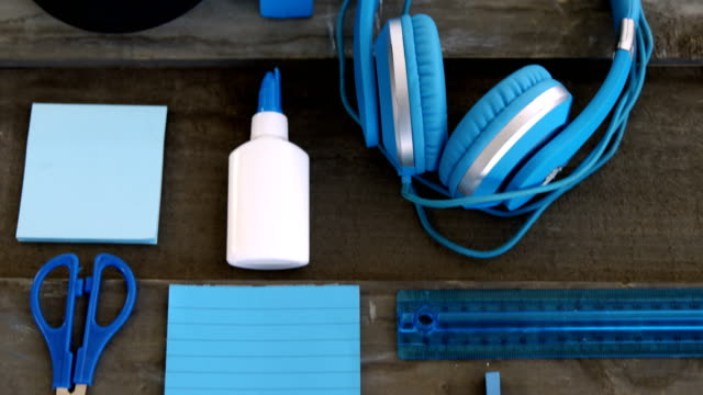 Headphone with other stationery on wooden table 4k