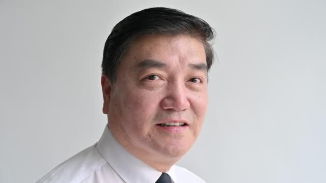 Headshot portrait of mature Chinese businessman