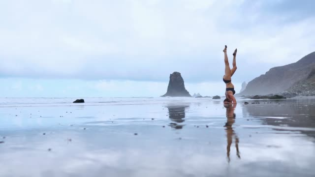 Headstand at the beach