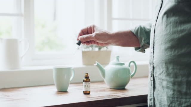 Healing with herbs 4k video footage of an unrecognizable senior man preparing a cup of medicinal tea at home cannabidiol stock videos & royalty-free footage