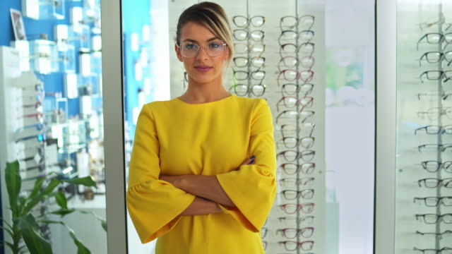Health care, eyesight and vision concept - Beautiful woman at optics store
