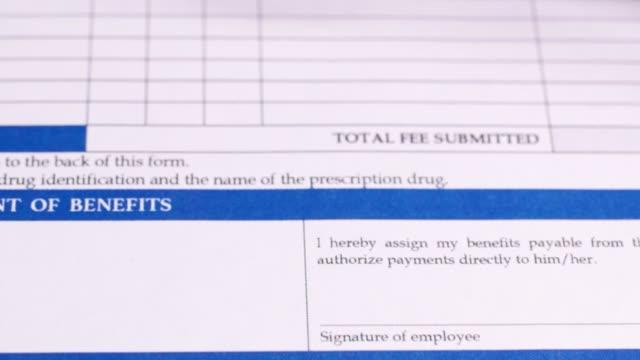 vídeos de stock e filmes b-roll de health insurance form - benefits