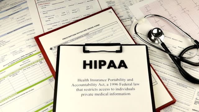 Health Insurance Portability and accountability act Health Insurance Portability and accountability act HIPAA, red folder with inscription confidential, medication request form and stethoscope on a blue velvet background. Close-up obedience stock videos & royalty-free footage