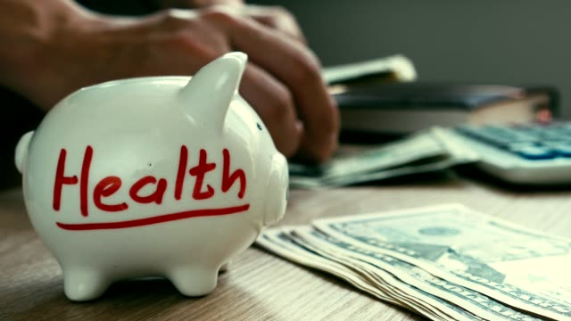 Health on a piggy bank. Cost of treatment. Money for medicine.