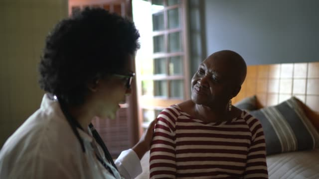 Health visitor and a senior woman during nursing home visit Health visitor and a senior woman during nursing home visit cancer patient stock videos & royalty-free footage