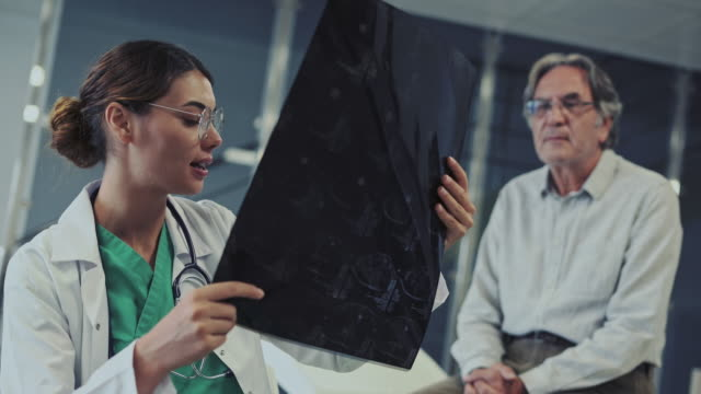 Health worker looking at x-ray Health worker looking at x-ray radiologist stock videos & royalty-free footage