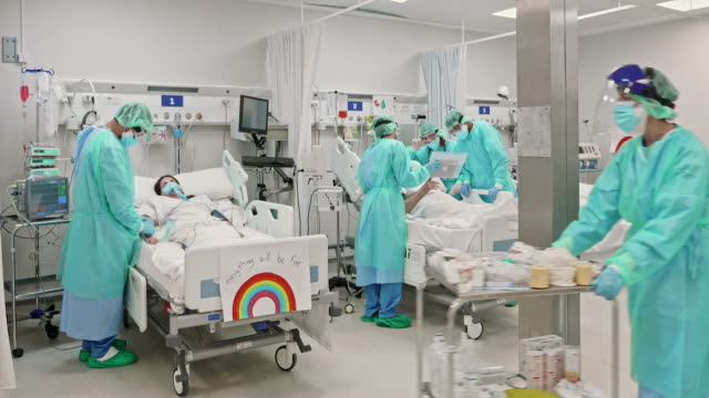 Healthcare people working at ICU during the pandemic