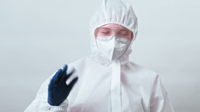 healthcare scientist ppe showing doubtful result - google filmów i materiałów b-roll