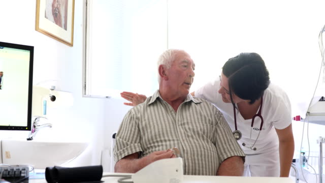 Healthcare Worker Doing a Medical Check-up on Senior Man - video