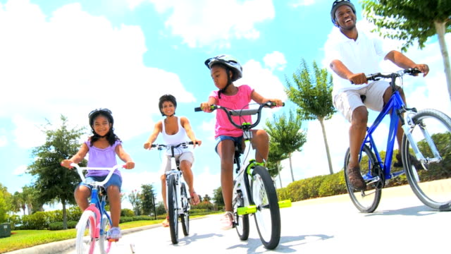 Healthy African American Family Cycling Together video