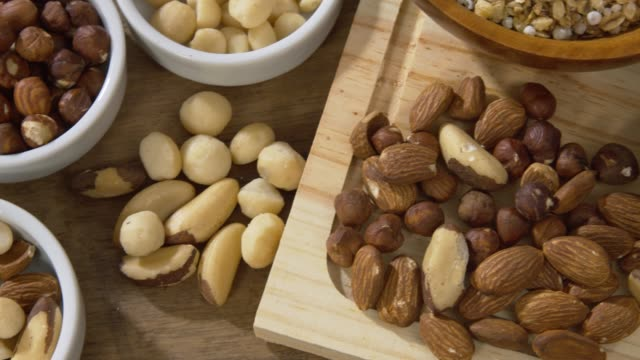 Healthy and beneficial food Bowl of Brazil nuts. Healthy and beneficial food stock video. snack stock videos & royalty-free footage