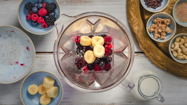 Healthy Breakfast - Smoothie Bowl with berry fruits, nuts and granola. 4k Stop motion animation Video Clip - loopable  - Step by step preparation - recipe is available ingredient stock videos & royalty-free footage