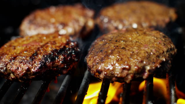 healthy diet flame grilled beef burgers on barbecue - burgers stock videos and b-roll footage