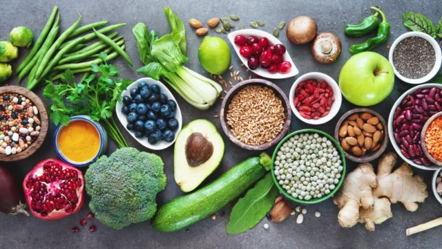 Healthy food selection Healthy food selection with fruits, vegetables, seeds, superfood, cereals on gray background healthy lifestyle stock videos & royalty-free footage