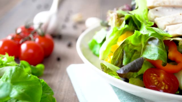 Healthy fresh green salad with boiled chicken breast Colorful fresh homemade healthy salad with boiled chicken breast, closed up dolly shot leaning stock videos & royalty-free footage