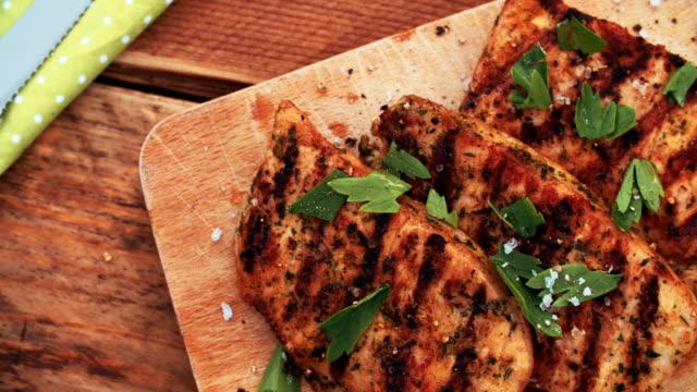 Healthy grilled pork fillets sprinkled with fresh herbs video