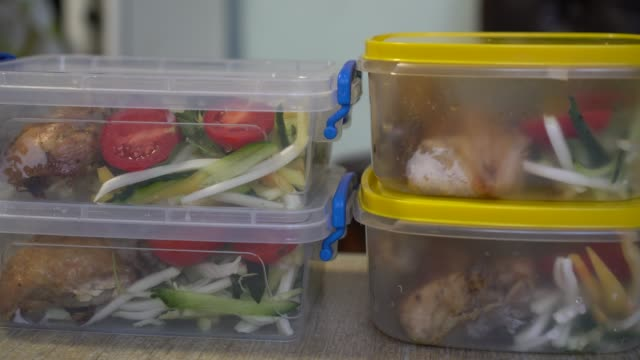 Healthy meal prep containers with chicken and vegetables Takeaway Food In Plastic Containers food stock videos & royalty-free footage