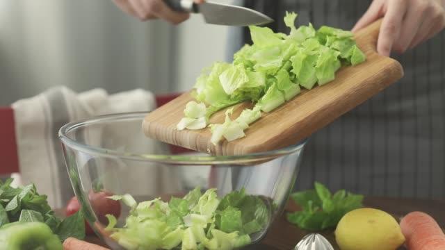 healthy nutrition salad preparing concept - lattuga video stock e b–roll