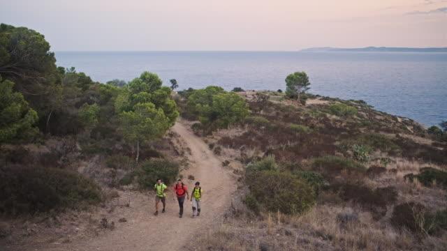 Healthy Spanish Friends Hiking Along Mediterranean Coast