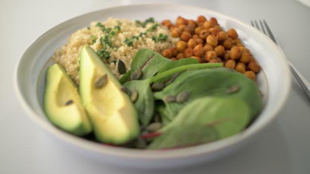 hälsosam vegan skål - gaffel bildbanksvideor och videomaterial från bakom kulisserna