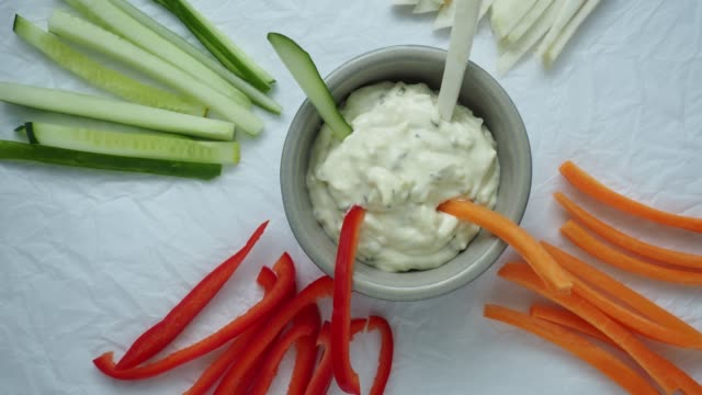 healthy vegetables and dip snack. vegetable sticks and dips in bowl. - immergere video stock e b–roll