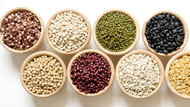 healthy white kidney beans in wood bowl food organic top view texture ,supplementary food, High protein healthy food healthy white kidney beans in wood bowl food organic top view texture ,supplementary food, High protein healthy food protein stock videos & royalty-free footage
