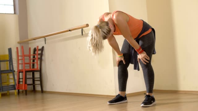 vídeos de stock e filmes b-roll de healthy woman exhausted after training workout - training
