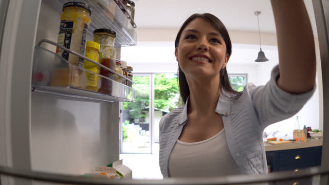 Healthy woman taking food from the fridge for her breakfast video