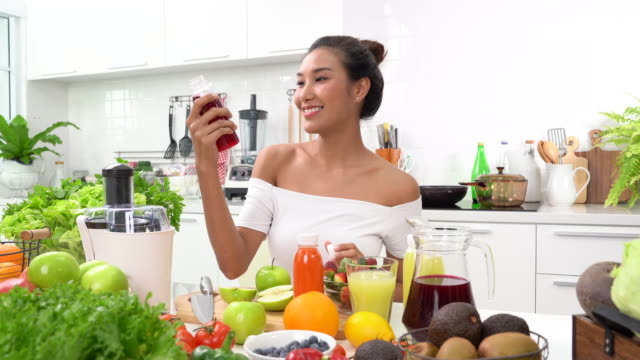healthy young woman drinking juice - healthy green juice video stock e b–roll