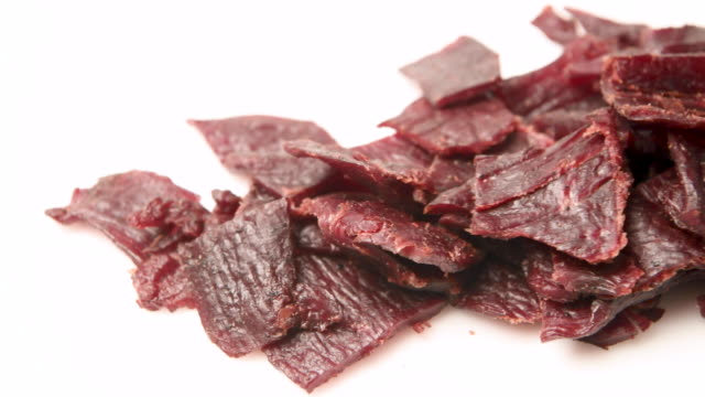 Heap of Beef jerky close up Heap of Beef jerky close up on white background jerky stock videos & royalty-free footage
