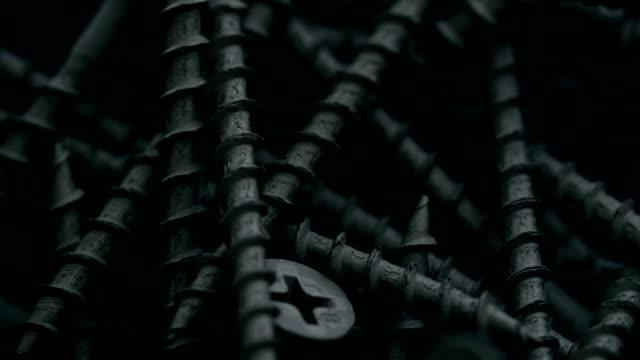 heap of black self-tapping screws - винт стоковые видео и кадры b-roll