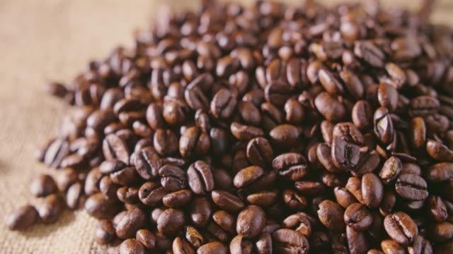 Heap Of Fresh Roasted Coffee Beans On Hessian Sack 4K video