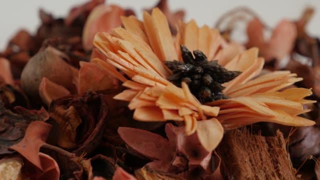 Heap of orange flowers in a bowl slow pan 4K