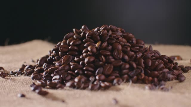 Heap Of Roasted Coffee Beans On Hessian Sack 4K video