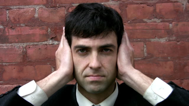 Hear no evil. Businessman puts hands to ears. Hear no evil. covering stock videos & royalty-free footage