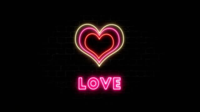 hjärta - 4k neon valentines koncept med en text - mjukhet bildbanksvideor och videomaterial från bakom kulisserna
