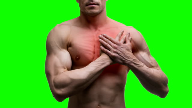 Heart attack, elderly muscular man with infarction on green background, chroma key 4K video video