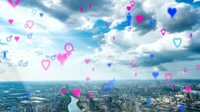 herz-emoji-symbole fliegen von gebäuden in den himmel, die dating-app. für soziale netzwerke mit digitalen verbindungen und netzwerken. zeitraffer über das stadtbild - online dating stock-videos und b-roll-filmmaterial